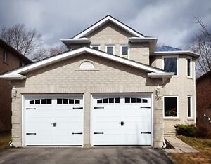 8x7 WHITE INSULATED CARRIAGE GARAGE DOORS..... $850 INSTALLED