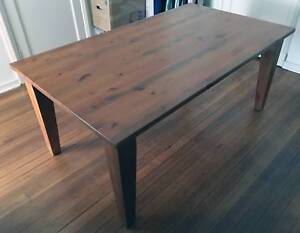 solid timber dining table with 6 timber chairs