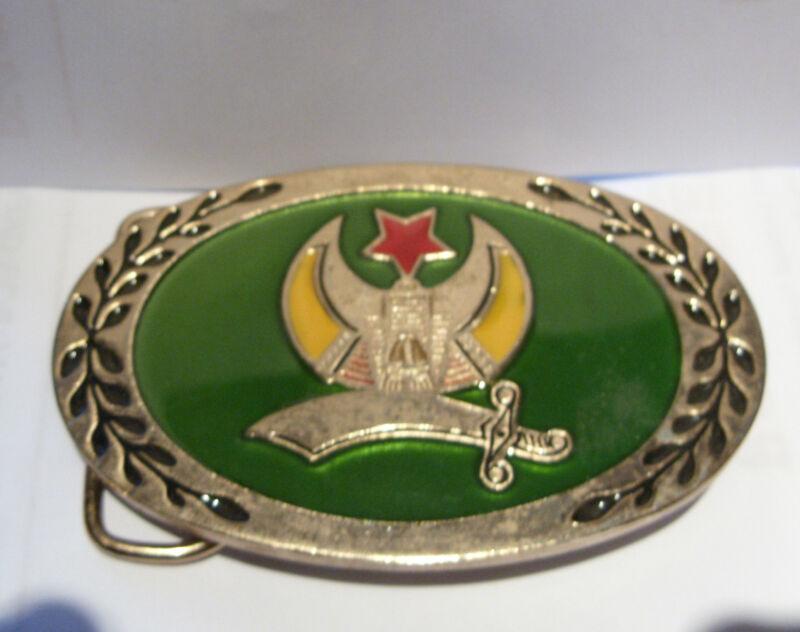 VINTAGE SHRINERS  BELT BUCKLE GREEN BACKGROUND STAR SWORD