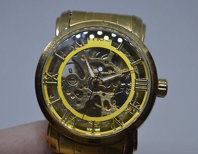 MCE Mens Watch Mechanical Automatic Self Winding Skeleton Gold Tone Foksy Co. ()