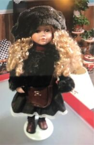 BEAUTIFUL PORCELAIN. DOLL WITH BLONDE CURLS