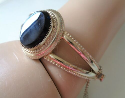 Vintage, Gold Tone, and Glass Black Cabochon Hinged Bracelet w/Security Chain.