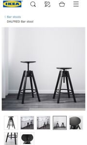 Two black Ikea Dalfred stools