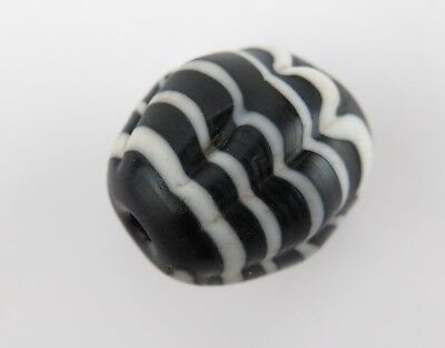 Trade bead. Phoenician type black and white melon bead