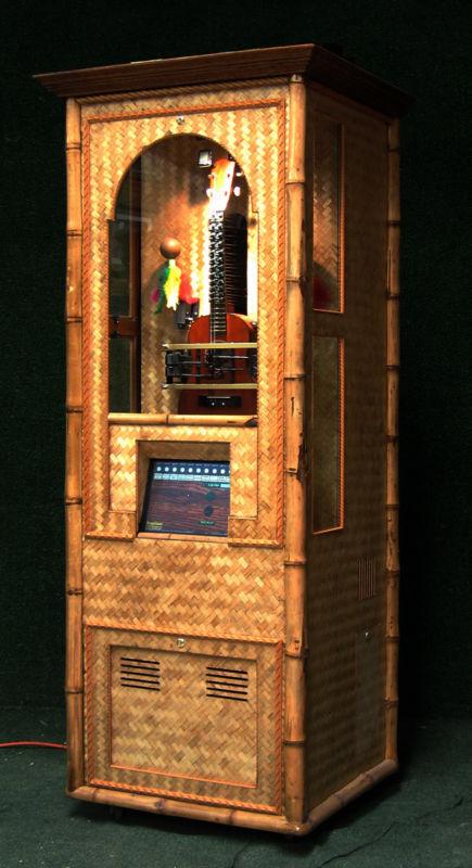 automated Ukulele in cabinet jukebox