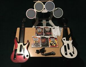 Wii Guitar hero bundle 2 guitars, mic drums, 5 games