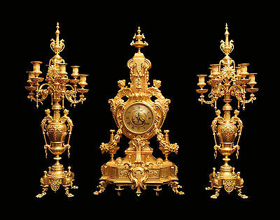 ANTIQUE FRENCH GOLD PLATED BRONZE LOUIS XVI CLOCK AND CANDELABRA - 1850-1899