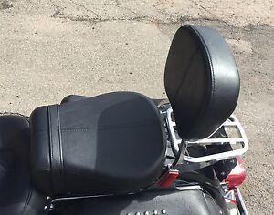 Passenger seat sissy bar and luggage rack off heritage Softail.
