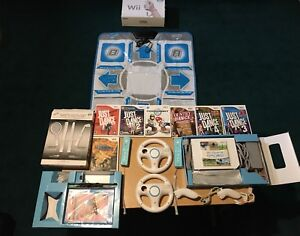 Wii bundle with 8 games, mario kart, dance mat, Wii sports