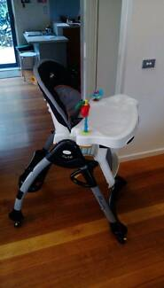 HIGH CHAIR Easyfold has 2 trays, layback, wheels & goes up & down