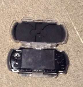 PSP with original case, comes with games and working charger