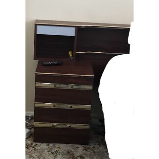 Behind bed cabinet and bedside tables