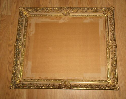 LARGE ORNATE WOODEN PICTURE FRAME -23 3/4X 20