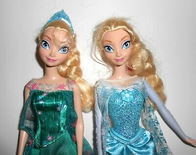 "2 Disney Frozen Queen Elsa Twin Barbie Dolls Clothes Gowns One Sings ""Let It Go"""