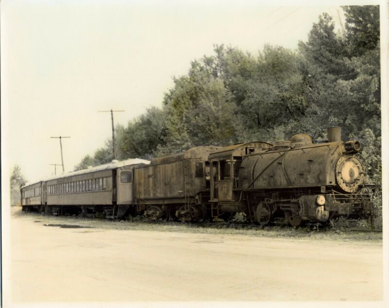 Hand colored Black and White Passenger train Photo.