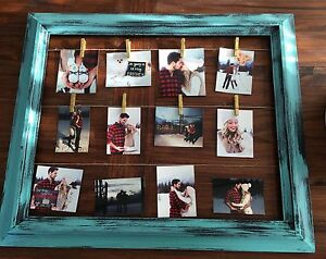 Teal photo holder frame.
