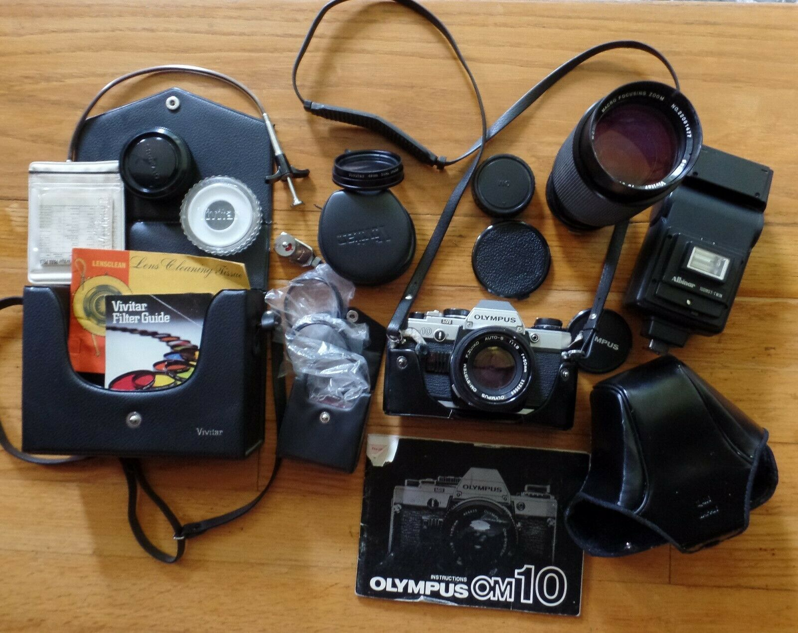 VINTAGE OM10 CAMERA WITH 50mm LENS, CASES, FLASH, FILTERS, PAPERS ACCESSORIES - $72.00