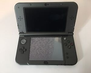 Nintendo 3Ds XL with game and charger