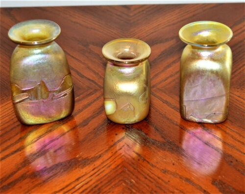 Three small Robert Held vases with iridescent favrile gold and purple blue-green