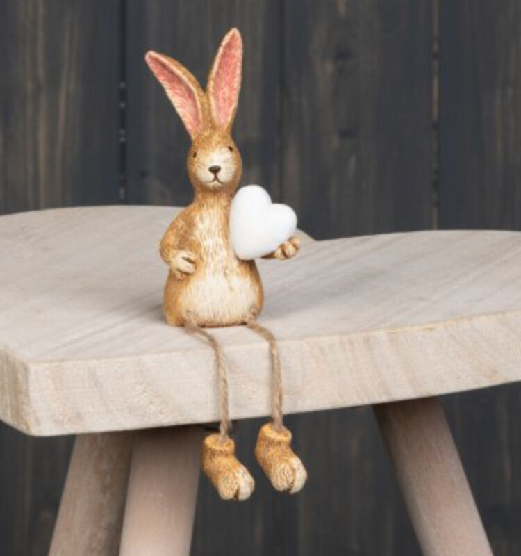 A Sweet Resin Bunny rabbit ornament with dangly legs holding a Small White Heart