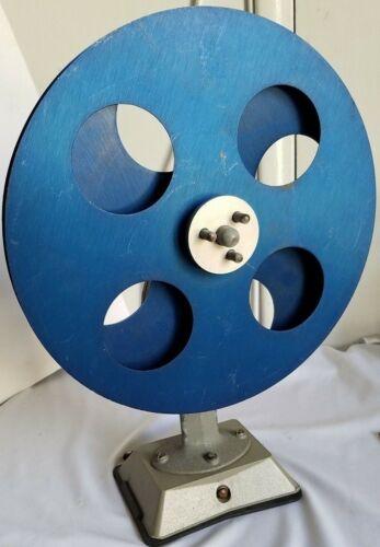 VINTAGE METALLIC BLUE MOVIE FILM REWINDER W/SUCTION BASE. WOOD HANDLE HAND CRANK