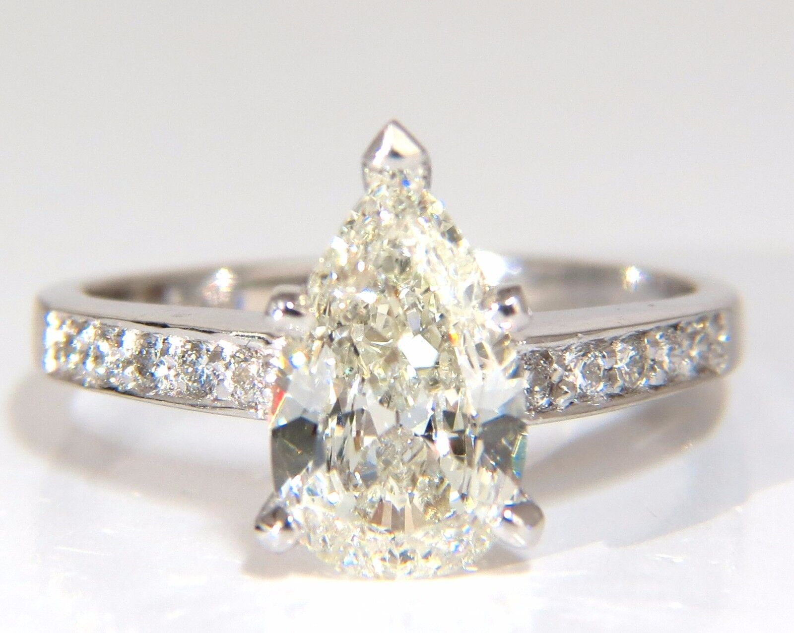 GIA Certified 1.49ct Pear Shape diamond ring .20ct. round accents 14kt 3