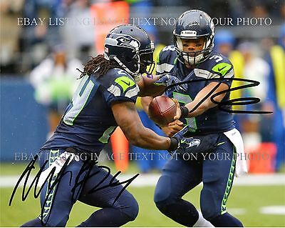 RUSSELL WILSON AND MARSHAWN LYNCH SIGNED AUTOGRAPHED 8x10 RP PHOTO SEATTLE