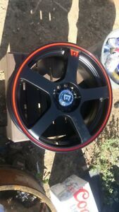 Four 17 inch motegi racing wheels