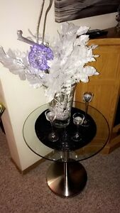 Glass end table with metal bottom