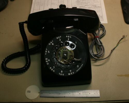Retro Rotary Dial Telephone with latching hand piece never used!
