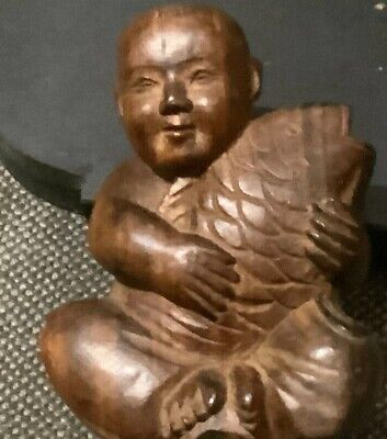 Old Carved Vietnamese Wooden Figural Depicting A Young Man Holding s Carp