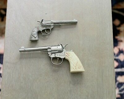 Two Vintage smoke cap pistols (Halco & Star with Long Horn Grip)