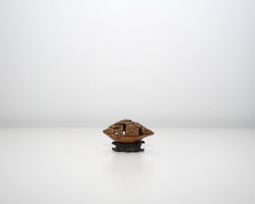A Miniature Nut Carving Boat with A Finely Carved Wooden Stand