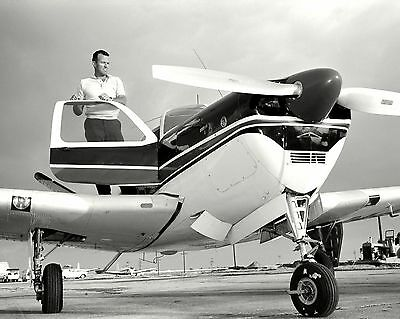 GORDON COOPER STANDS ON WING OF BEECHCRAFT BONANZA AIRCRAFT  8X10 PHOTO (AA-564)