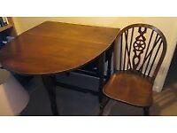 Dark oak gateleg dining table and 4 wheel back chairs