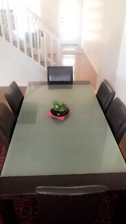 Dinning table with 6 chairs and a coffee table