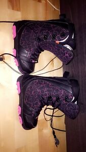 Ladies size 7 snowboarding boots.
