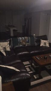 4month old black leather sectional with tables