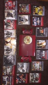 ps3 with two controllers and a lot of games