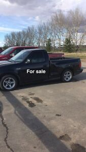99 ford lightning and 2010 24 ft enclosed car hauler