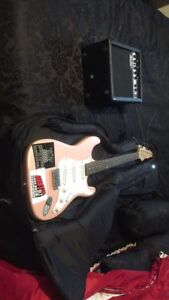 Pink and white stedman guitar with amp
