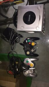 GameCube with 2 controllers and games