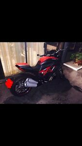 Selling Ducati Diavel Red-Carbon in NEW condition