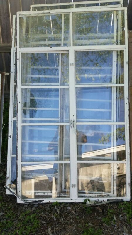 """Large Vintage Industrial steel Casemate Windows. 63 & 1/4"""" tall by 37"""" wide."""