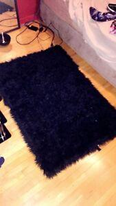 fuzzy Black area rug
