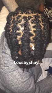Dreadlocks Stylist interlocking and palm rolling