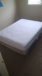 Double mattress with Box Spring and Meatal Frame.