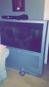 Tv and couch for sale 70 for both 50$for tv /20$ for couch
