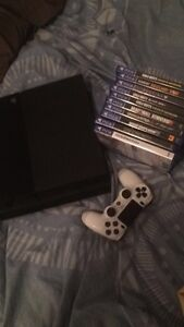 PlayStation 4 with a Controller and games