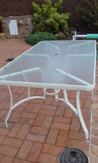 Glass topped outdoor dining table